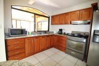 7428_3569_008-cocina-392-nuevoshorizontespropiedades-venta-sevende-casa-condominio-la-ladera-Heredia.jpg